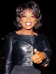 Oprah Visits Army Base Bearing Baby Gifts