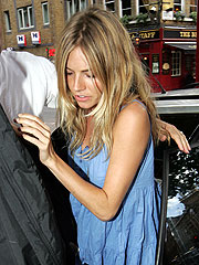 Sienna Takes Off Jude's Engagement Ring
