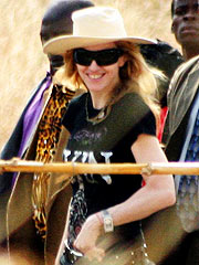 Madonna Lands in Malawi with Son David