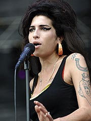 Amy Winehouse's Mom Is 'Glad' the Singer's Husband Is In Jail