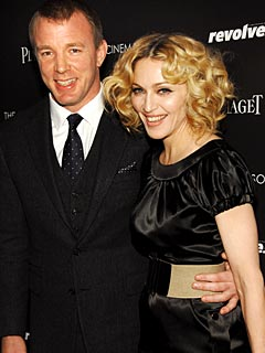 Madonna and Guy Don't Read Tabloids, Says Pal