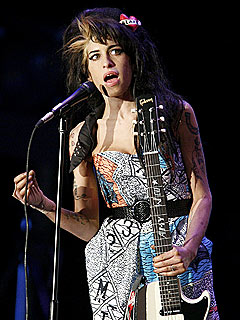Report: Amy Winehouse Lashes Out at Fan