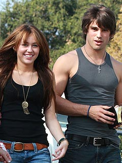 Justin Gaston: I Don't Live with Miley