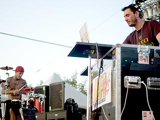 Photos of Travis and DJ AM in Concert Before Tragedy Struck