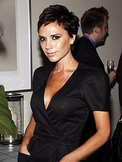 Victoria Beckham Admits to (Gasp!) Smiling