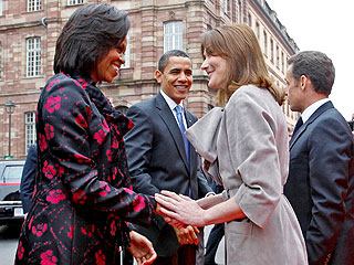 Michelle Obama Presents Carla Bruni-Sarkozy with a Guitar