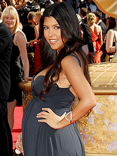 Kourtney Kardashian Shows Off Her Baby Bump