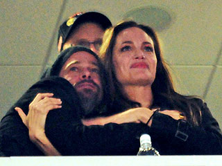 Brad Pitt and Angelina Jolie in Loving Mood at the Super Bowl