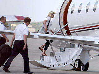 Elin Nordegren Jets Off (Solo) to Visit Her Mom in Hospital