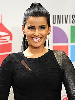Nelly Furtado to Donate $1 Million from Gaddafi to Charity