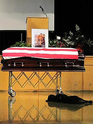Navy SEAL's Dog Sits by Coffin at Funeral