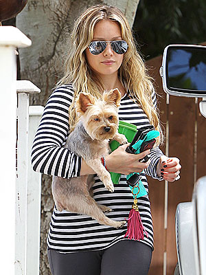 Hilary Duff Pregnant, Hides Baby Bump with Dog