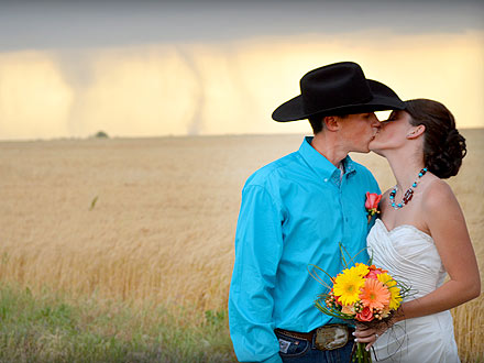 Tornadoes in the Background as Newlyweds Kiss