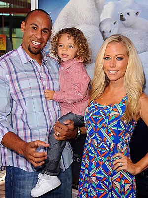 Kendra Wilkinson Helps Her Two Hanks