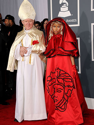 2012 Grammy Awards: Nicki Minaj Walks Carpet with Pope Lookalike