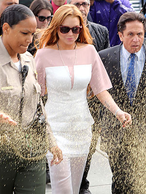 Lindsay Lohan Gets Hit with Glitter on Way to Court