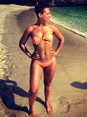 Alicia Keys Channels Halle Berry's Bond Girl in Orange Bikini