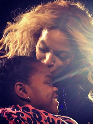 Beyoncé Kisses Madonna's Daughter During 'Mrs. Carter' Show