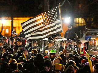 15 Powerful Images from Last Night's Ferguson Demonstrations