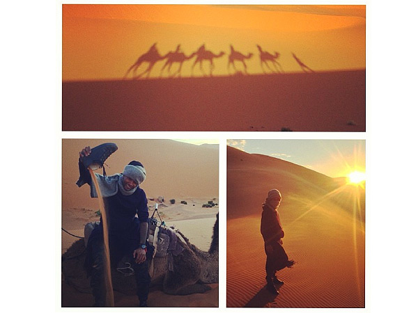 Usher Rides a Camel and Camps in the Sahara Desert