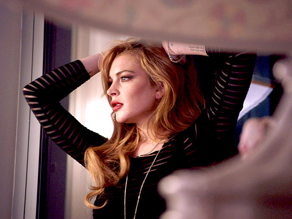 Lindsay Lohan Strikes Somber Pose in First-Look Photo for Reality Show