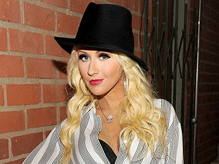 Christina Aguilera 'Glowing' at Miley Cyrus Concert