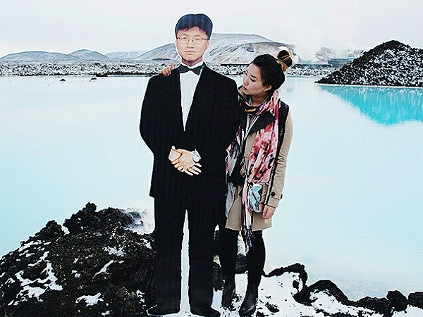 Jinna Yang of Grease & Glamour Travels with Cutout of Father