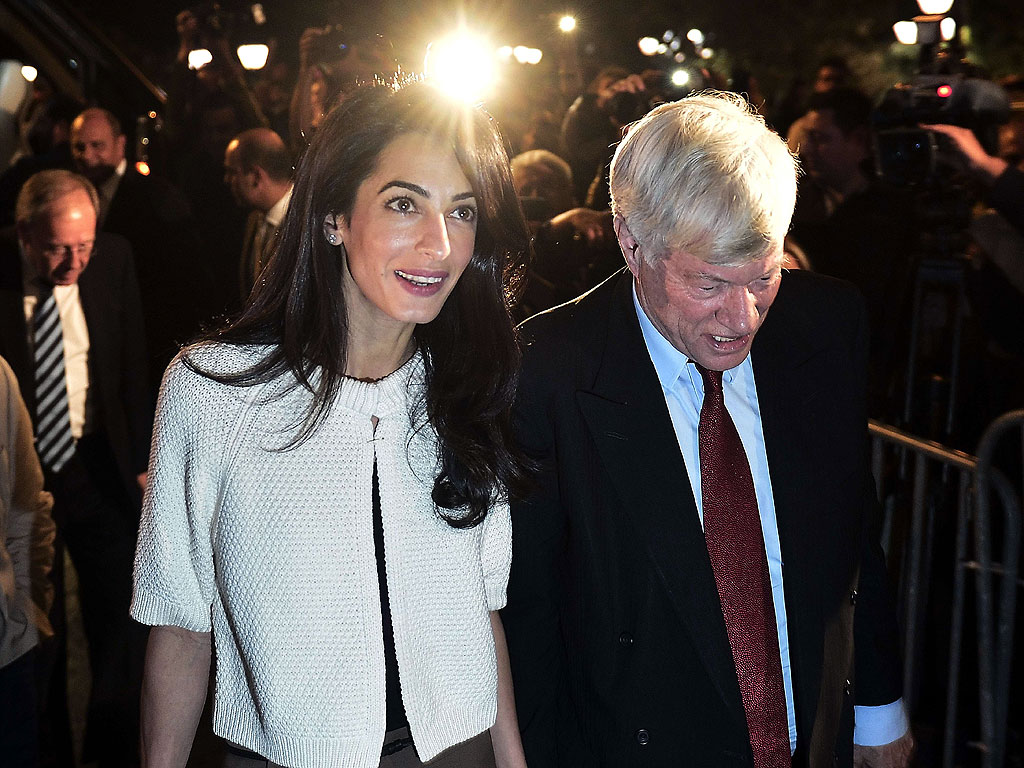 With a New Name, Amal Clooney Gets Back to Work – in Greece