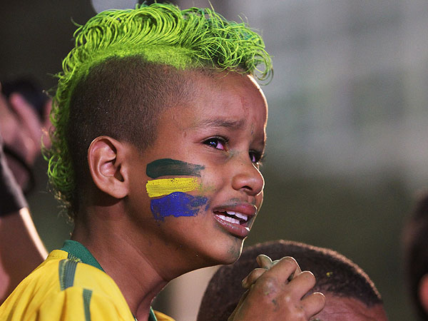 Sad World Cup Fans Highlight Brazil's Loss to Germany (PHOTOS)