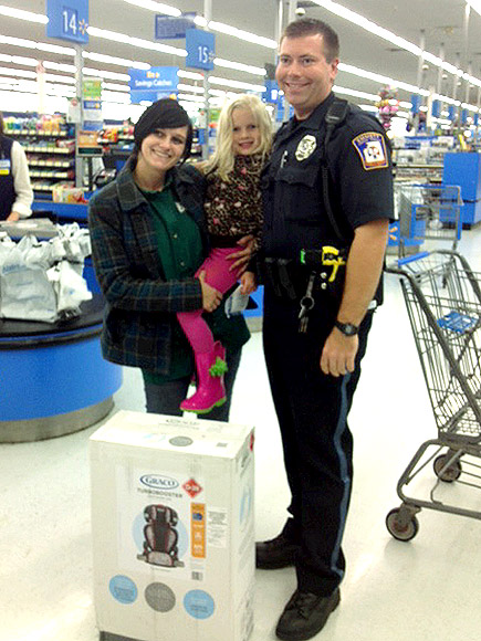 Instead of ticket, Michigan officer buys girl booster seat