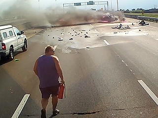 Truck Driver Rescues Family Caught in Burning Car (VIDEO)