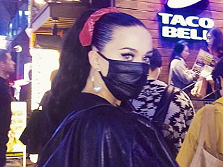 A Masked Katy Perry Waits in Line for an Hour to Eat at Tokyo's First-Ever Taco Bell