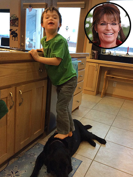Sarah Palin Posts Photos Of Son Trig Using Family Dog As A