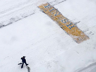 These Men Cleaned the Boston Marathon's Finish Line Mid-Blizzard
