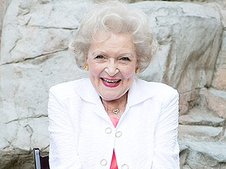 WATCH: Betty White Playing with Puppies and Making Paw Puns Could Not Be More Charming