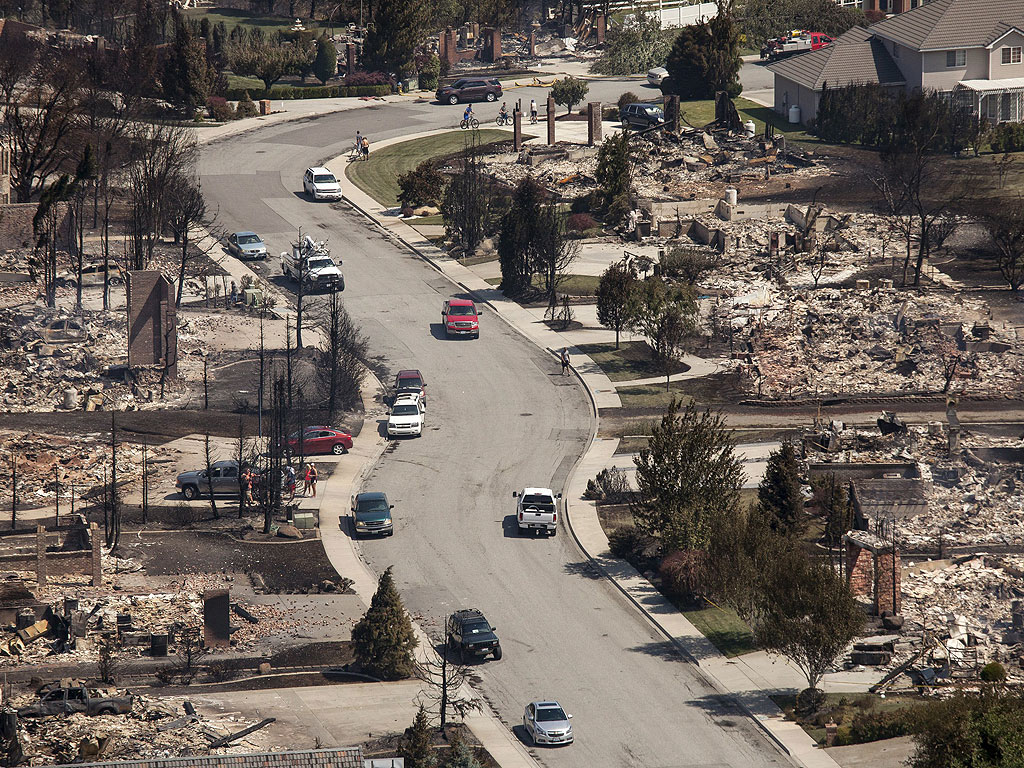 Wildfire wipes out entire suburb in washington state and for Home builders wa state