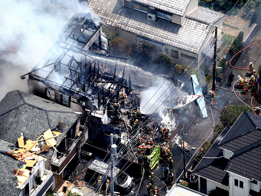 3 Dead, 5 Injured After Tokyo Plane Crash Sets Neighborhood on Fire