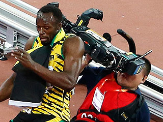 Watch Sprinter Usain Bolt Get Run Over by a Segway While Celebrating World Championships Win
