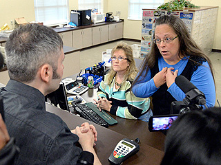 Kentucky Clerk Is Handcuffed and Charged with Contempt of Court for Refusing to Issue Marriage Licenses to Same-Sex Couples