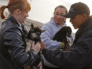 President Obama Meets Dog Sledding Champion John Baker and Reassures a Tiny Husky Puppy