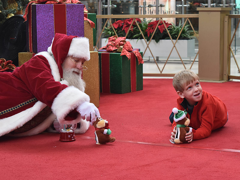 Kind Mall Santa Gets on the Floor for Boy with Autism