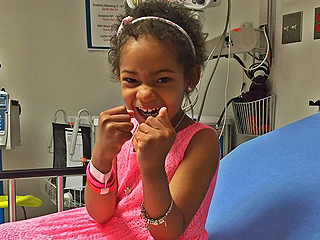 Devon Still Shares Sweet Pics from Surprise Trip for Daughter Battling Cancer