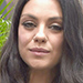 Pregnant Mila Kunis Showcases Her Baby Bump in Black Column Dress During Bad Moms Press Tour