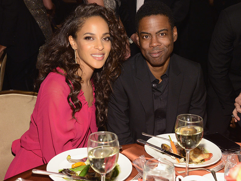 Megalyn Echikunwoke and Chris Rock at the Clive Davis 40th annual pre-Grammy Awards