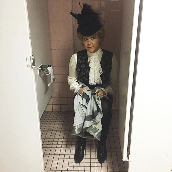 Amy Schumer Shows Off Her Bloomers Sitting on Toilet in Full Victorian Garb