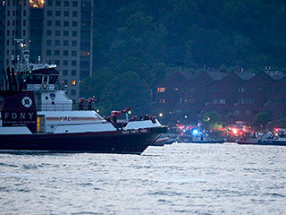 WWII Fighter Plane Crashes in Hudson River, Pilot Survives with Minor Injuries