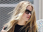 Amanda de Cadenet Comforts an Emotional Amber Heard After Court Date with Johnny Depp Is Pushed Back