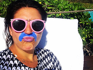 Why Is This Woman Wearing a Colored Zinc Mustache?