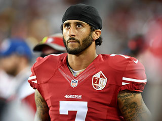 Colin Kaepernick Visits High School Team as They Join His Protest by Laying on the Ground with Their Hands Up