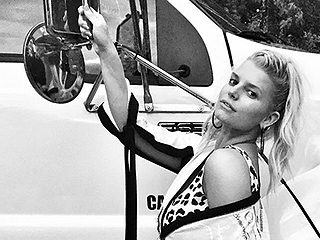 Jessica Simpson Flaunts Her Legs in Teeny Leopard Onesie Next to Giant Truck, Proves Her Car Model Game Is 100